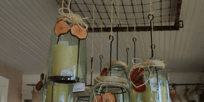 Use a rustic crib spring to hang items in your kitchen